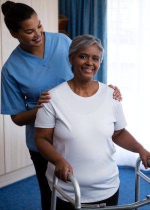 nurse assisting senior woman